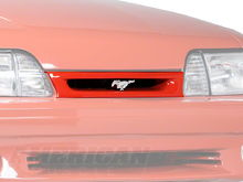 Today, I cut out the bar that holds the Ford oval on the front grille.  I will be upgrading to this 93 Cobra grille.  I always liked the look of the pony a lot more.
