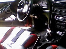 "Procar race seats, RJS 5 pt harnesses, B&M short throw shifter and T handle, Autometer 5"" tach, NO2 push button steering wheel"