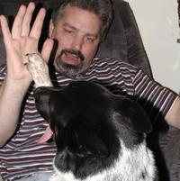 "High Paw! Man is dog's best friend! Boomer with my husband, whom I have nicknamed ""Dr. Doolittle"". All animals are drawn to my husband, well, except for my brothers Chihuaha, who comes to me and growls at my husband....curious~ ~ ;D"