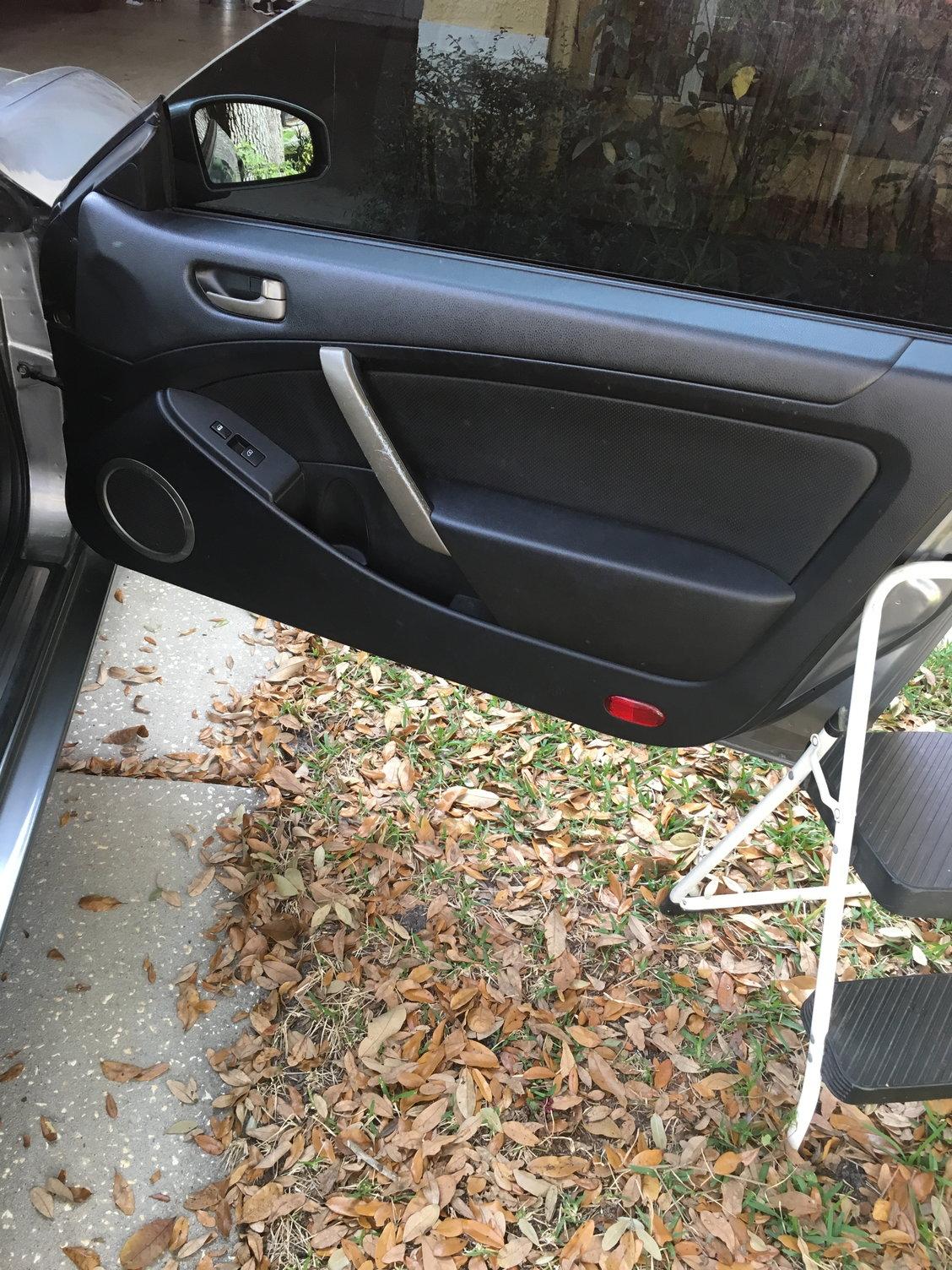350z driver side door won t open