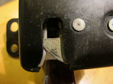 Latch Closed using a screw driver, shows the back side of the latch in proper position to hold the hatch closed.