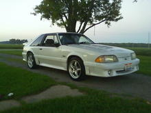 When i first bought her w/ my old 98 cobra rims