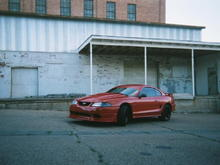 The car with the Y2K front bumper and hood.