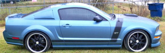 "Side view showing ground effects 20"" wheels an rear window deletes..."