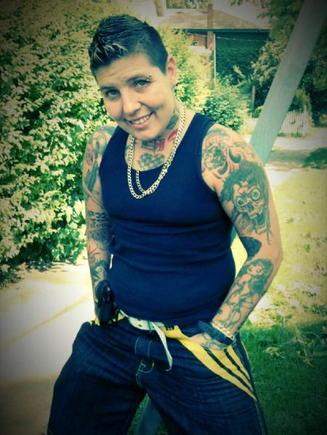 Tattooist in tank top