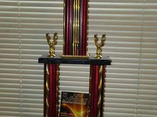 Got this trophy at Nopi also 1st place for a system that I did for a friend of mine Black Nissan Maxima two Kicker 12s CVR Memphis three way components TMA 1000.1 TMA 600.4 CUSTOM fiberglass enclosure spare tire well amp rack plexiglass see through..good times