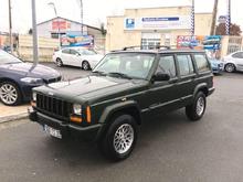 97 XJ Metallic green, beige interior.