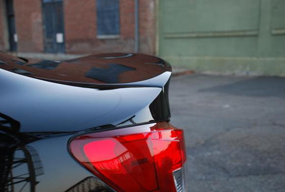 Wald trunk spoiler molded. Quarter panel raised to be flush to spoiler.
