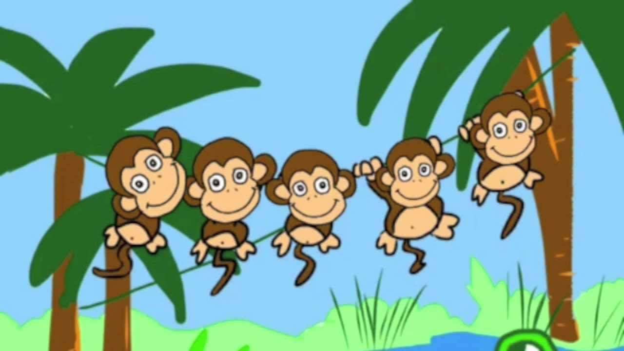 Pictures of cartoon monkey hanging from a tree free vector