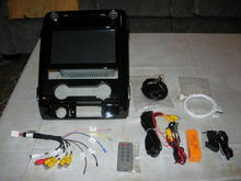 Entertainment unit with included accessories. Seller also added a camera/wiring and hole saw at no extra charge.