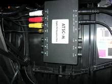 F150 HU install digital tv tuner velcroved to heater box behind glove box.