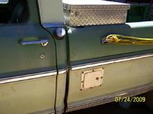 Driver side fuel door