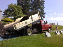 I use my truck as a work truck. Here I hauled and unloaded 3 yards of mulch to beautify a cemetery plot, summer of 2013.