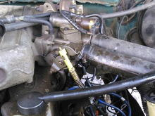 this is another view of my 4.9 inline 6 ford engine. as u can see it needs a lot of tlc. but before i do so i have to determine if the engine is worth repairing or if have to replace it.