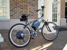 my ampedbikes.com hybrid (22 mph, 327 MPG, automatic windows, silent brushless motor, downside is the lack of heater!)