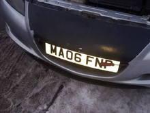 Front plate for MOT