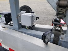 Used trailer bunk brackets for mounting the battery and electrical distribution box.