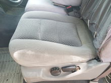 Drivers seat. Seat covers work great
