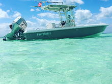 2007 Everglades 243 With BF225, optimal cruise at 4900 RPM 30mph/9.2 GPH with 4 blade Mercury RevProp.