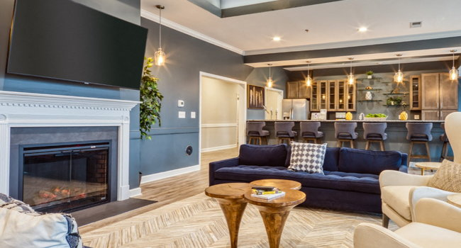 Fireplace, TV and seating at the Residents Clubhouse