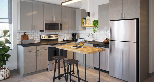 Our pet-friendly 1- and 2-bedroom industrial inspired lofts feature 9-foot, 4-inch ceilings with exposed structure and ductwork. Kitchens feature stone countertops and stainless steel appliances.